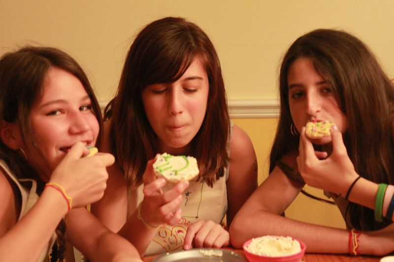 3 Girls Eating Cookies