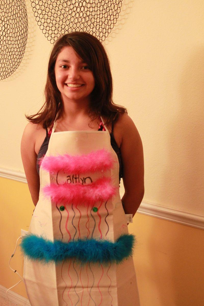 Caitlyn wearing apron